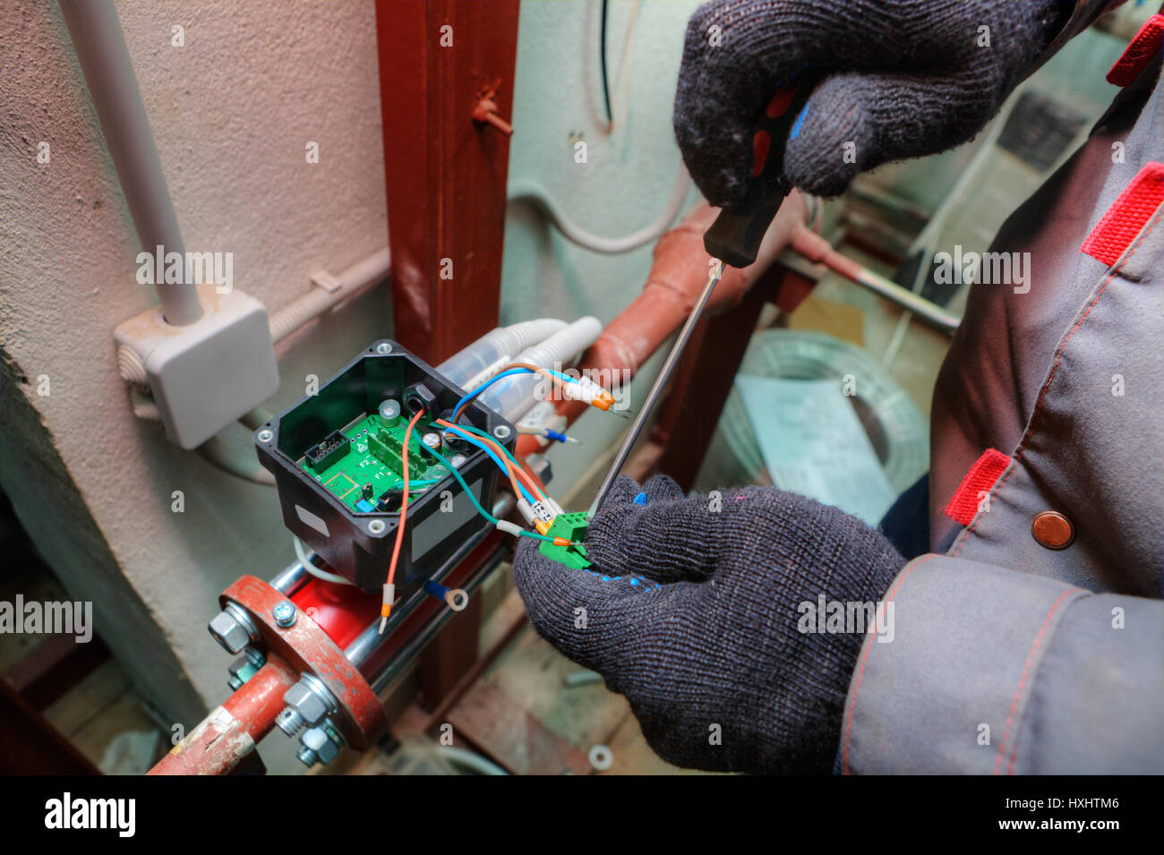 Mechanical engineer installs control devices for central heating ...