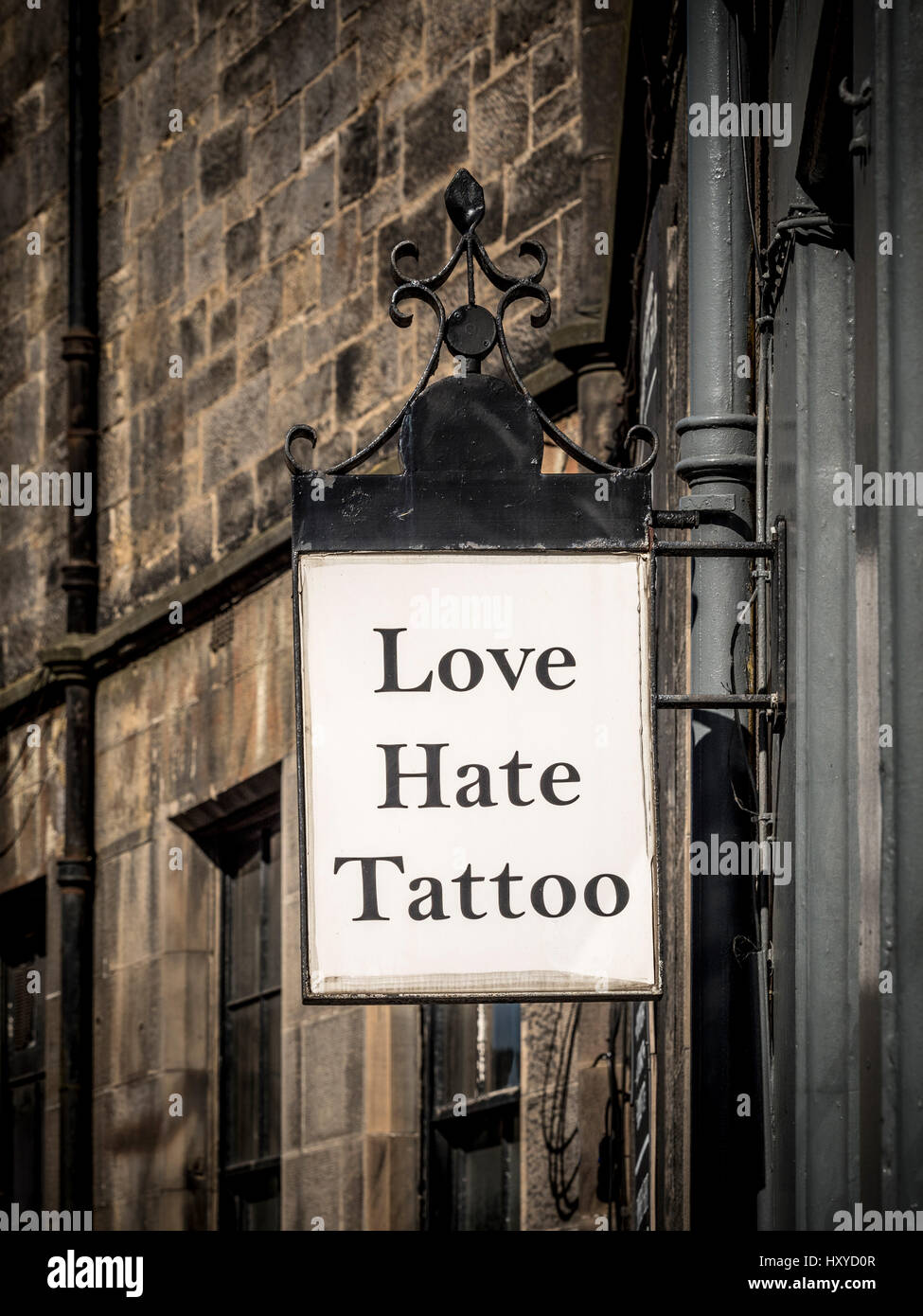 Love Hate Tattoo sign outside tattoo artist shop, Edinburgh, Scotland. - Stock Image