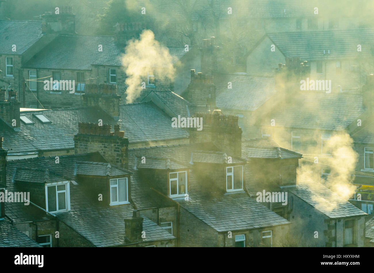 Smoking chimneys in the Moorlands area of Lancaster Lancashire England - Stock Image