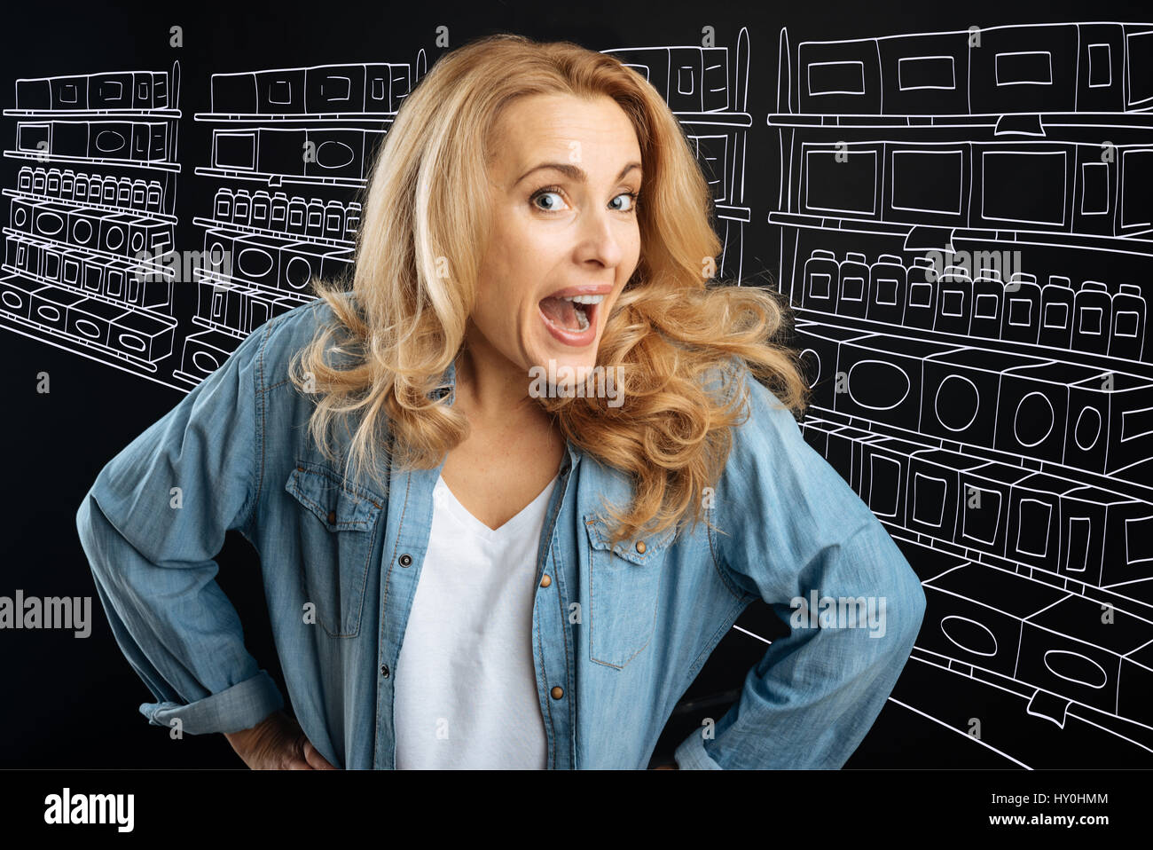 Nice emotional woman visiting a supermarket - Stock Image