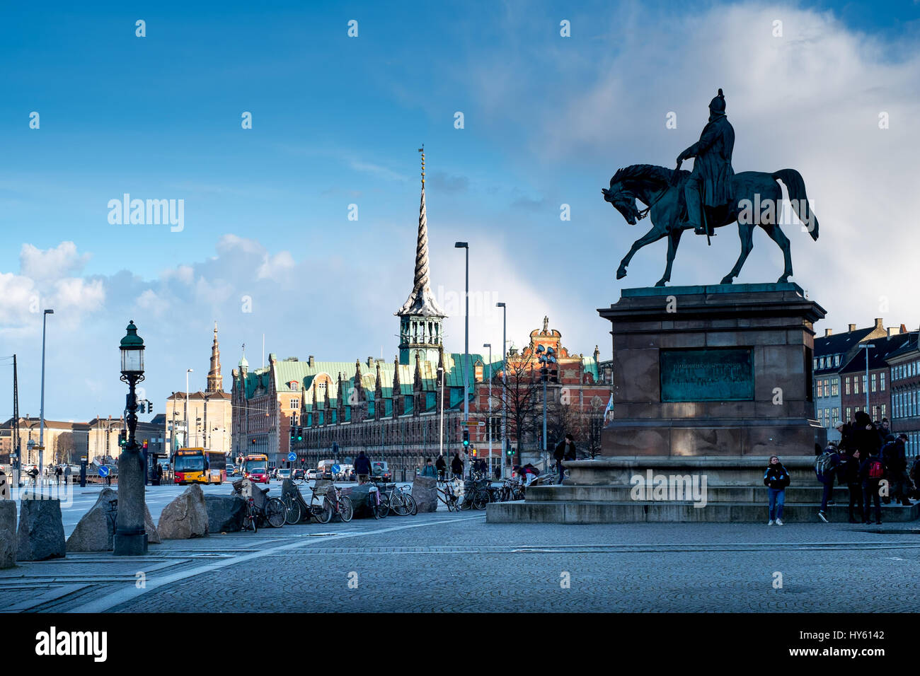 Striking equestrian statue of Christian IX with Børsen, a 17th century stock exchange in the background, Copenhagen, - Stock Image