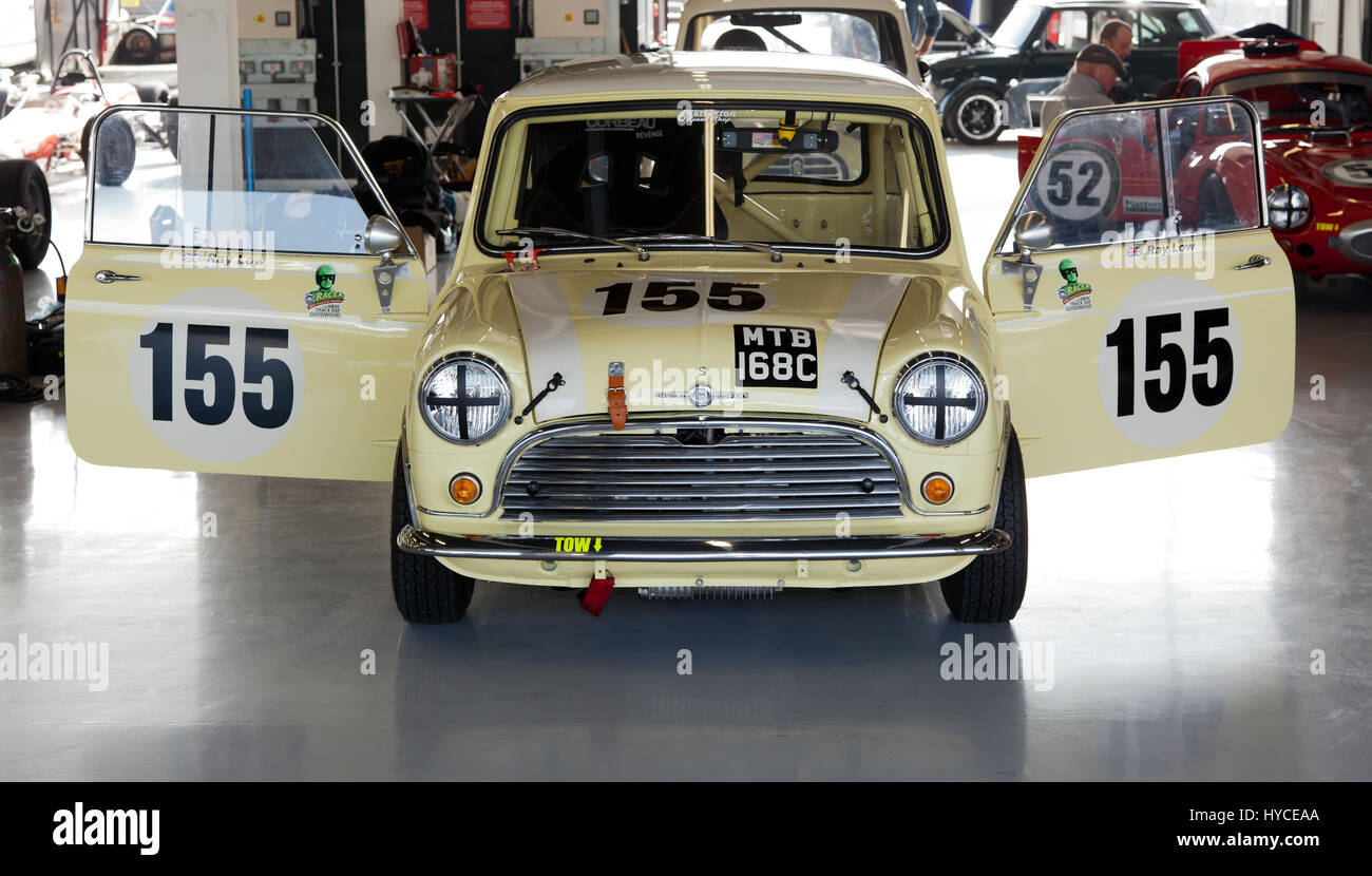 Ray Low's Classic Morris Cooper S racing Mini in the International Pit garage's  during the Silverstone - Stock Image
