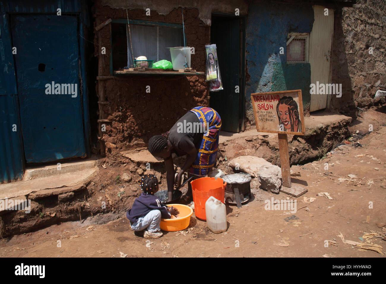 Woman And Child Wasting Outside Dreamland Hair Salon Kibera Slums