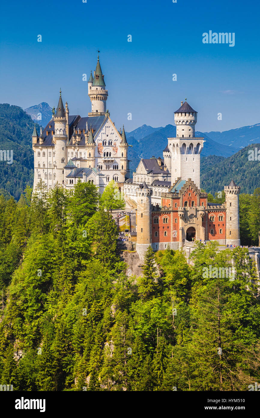 Beautiful view of famous Neuschwanstein Castle, the nineteenth-century Romanesque Revival palace built for King - Stock Image