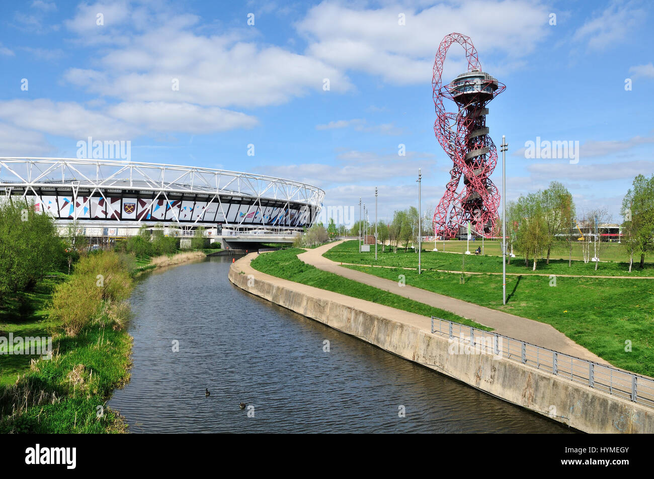 The London Stadium and City Mill River in the Queen Elizabeth Olympic Park at Stratford, East London UK - Stock Image