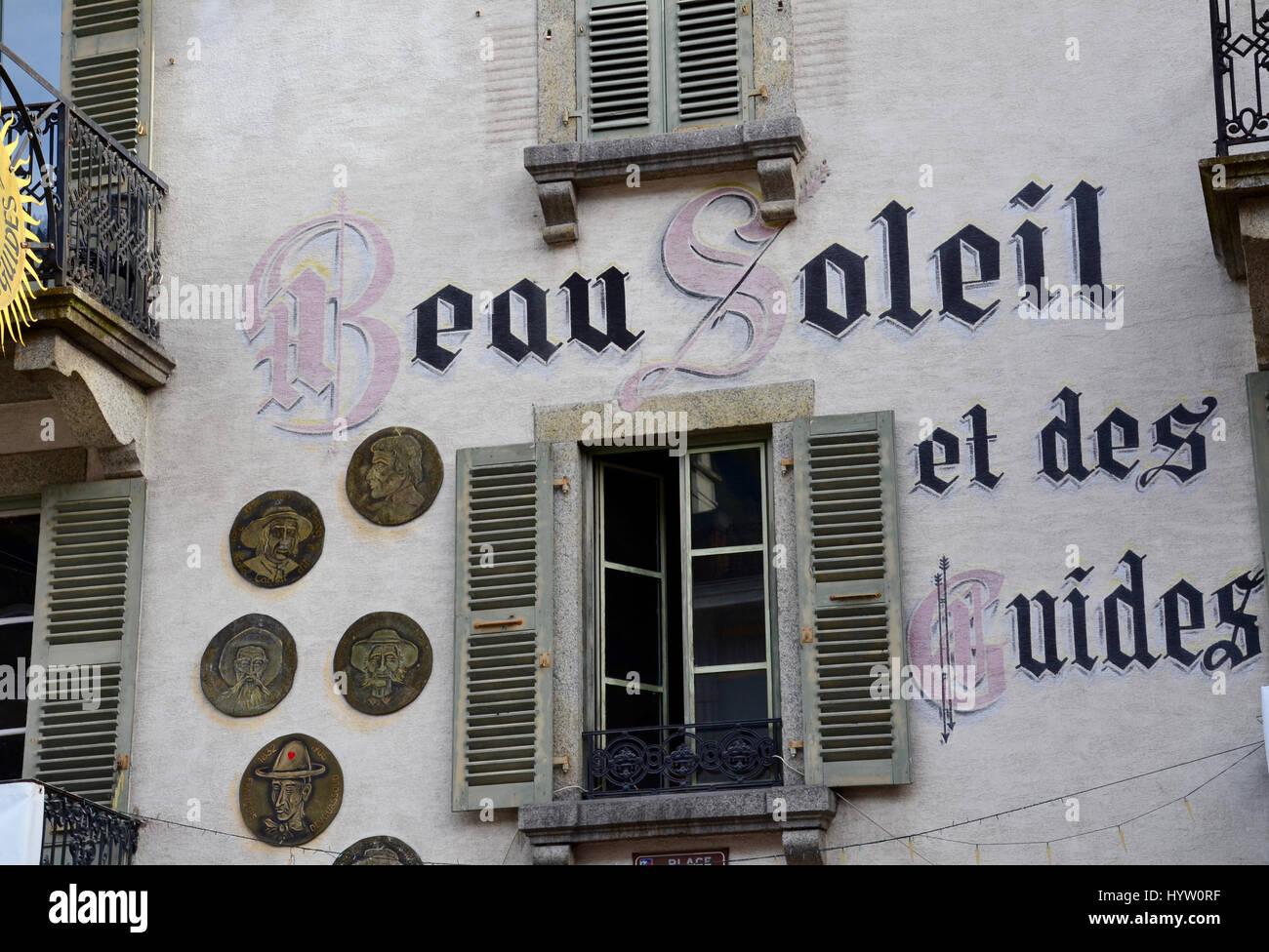 French advertising on building in Geneva, Switzerland (Translation: Beautiful Sun) - Stock Image