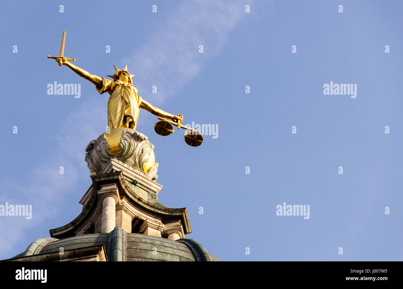 London, England - March 20, 2009: A statue of Justice stands over England's Central Criminal Court on London's Old Stock Photo