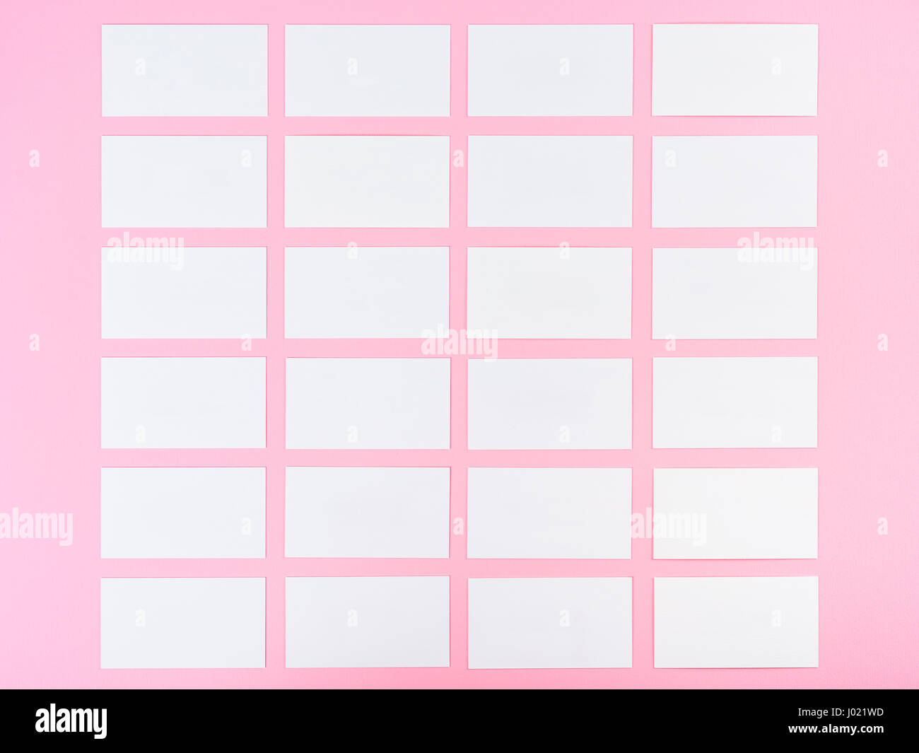 White blank business cards on pink background with fine paper white blank business cards on pink background with fine paper texture reheart Image collections