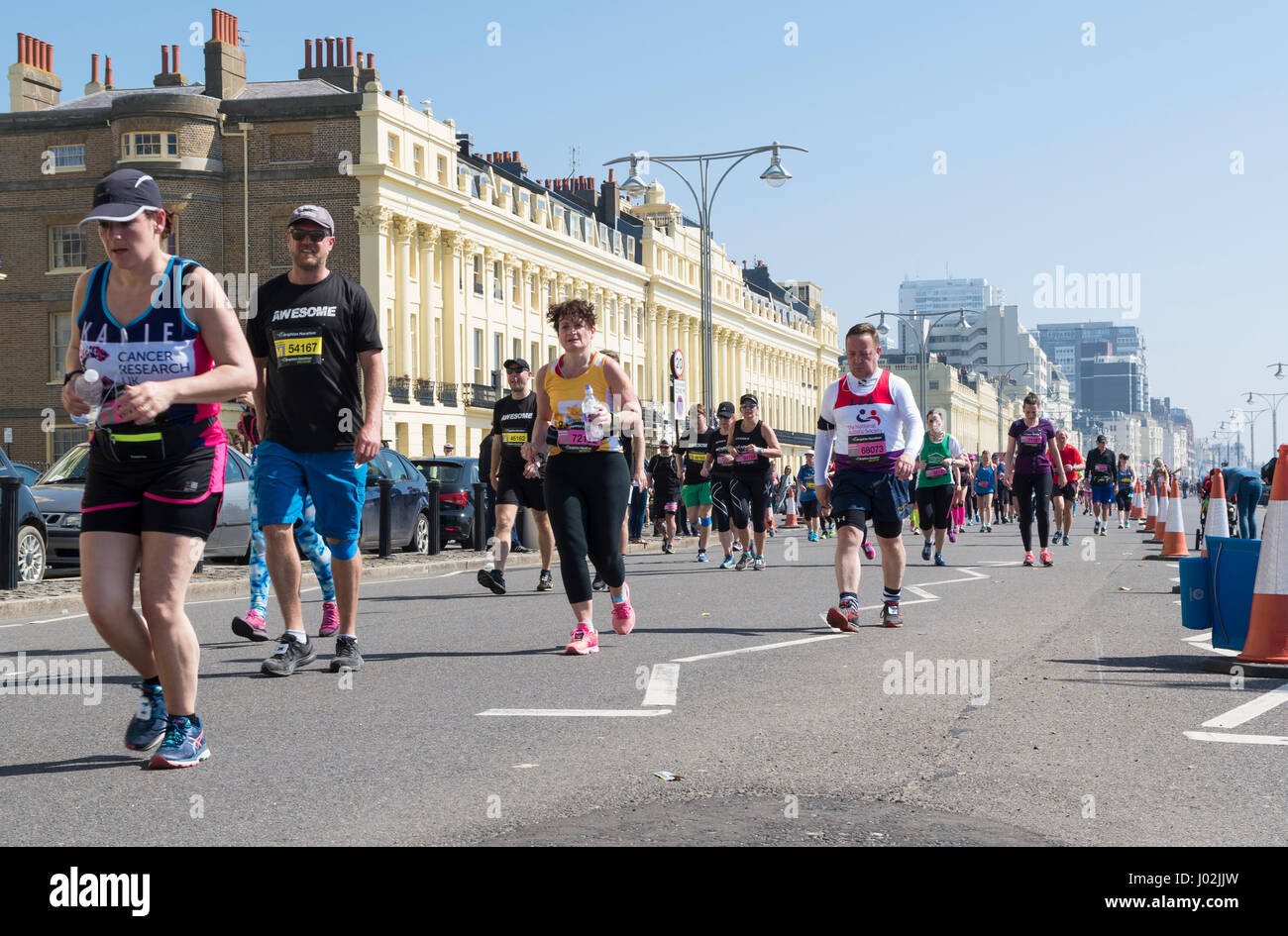 Brighton, UK. 9th Apr, 2017. Thousands of people braved the heat on the hottest day of the year so far to participate - Stock Image