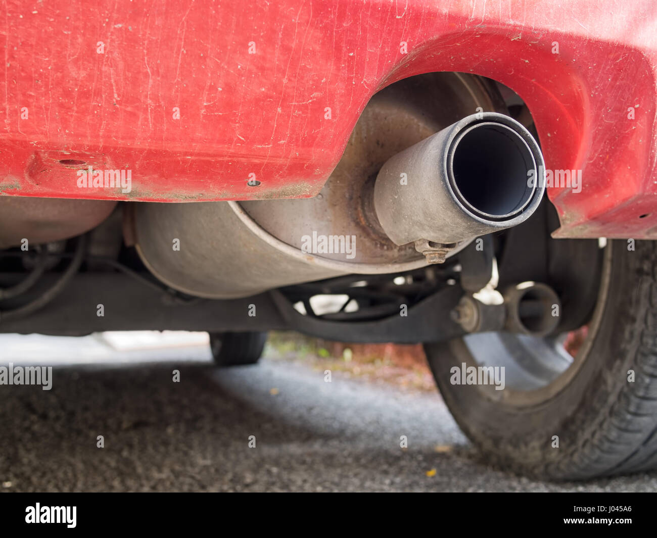 Diesel car exhaust with visible soot. Stock Photo