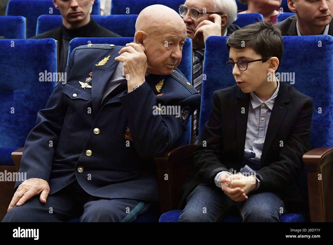 Moscow, Russia. 12th Apr, 2017. First cosmonaut to perform a spacewalk Alexei Leonov (L) attends an event marking - Stock Image