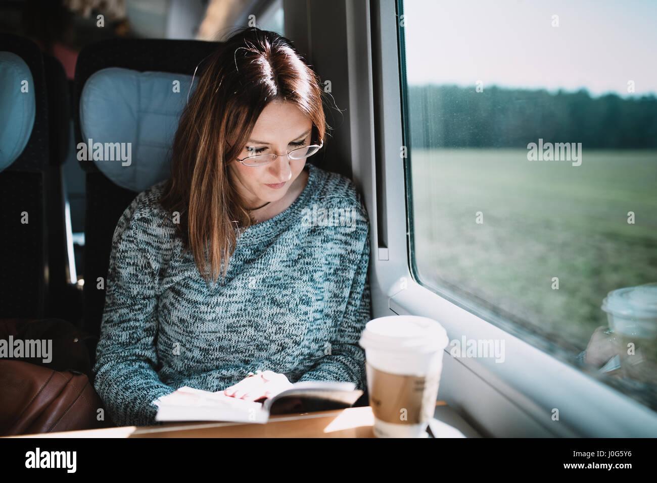 women reading book on the train stock photo 138038858 alamy