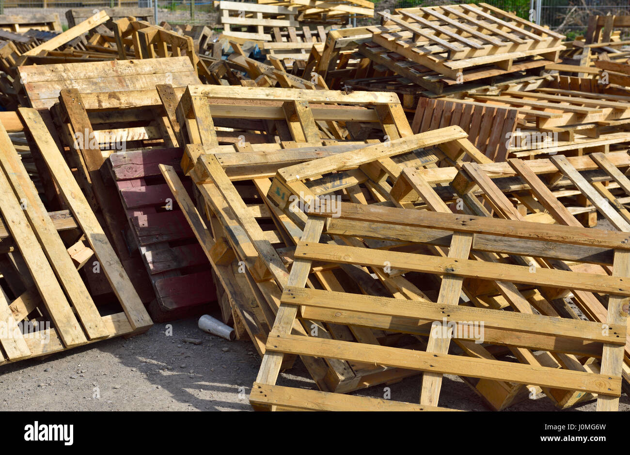 wooden pallets and scrap wood for recycling stock photo 138134721
