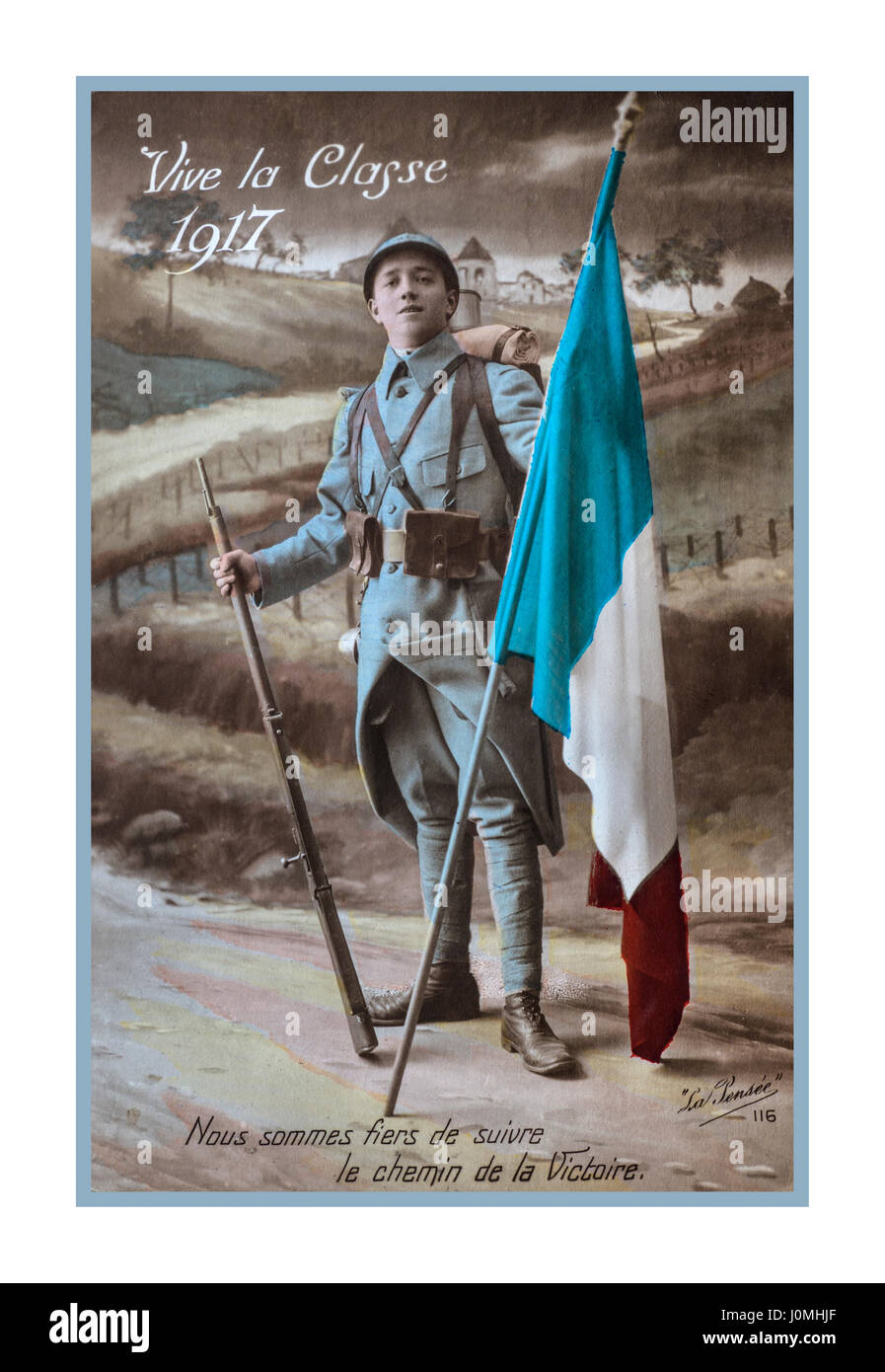 WW1 1914-1918 propaganda postcard with French infantry soldier holding tricolor flag dated 1917 from the battlefront - Stock Image