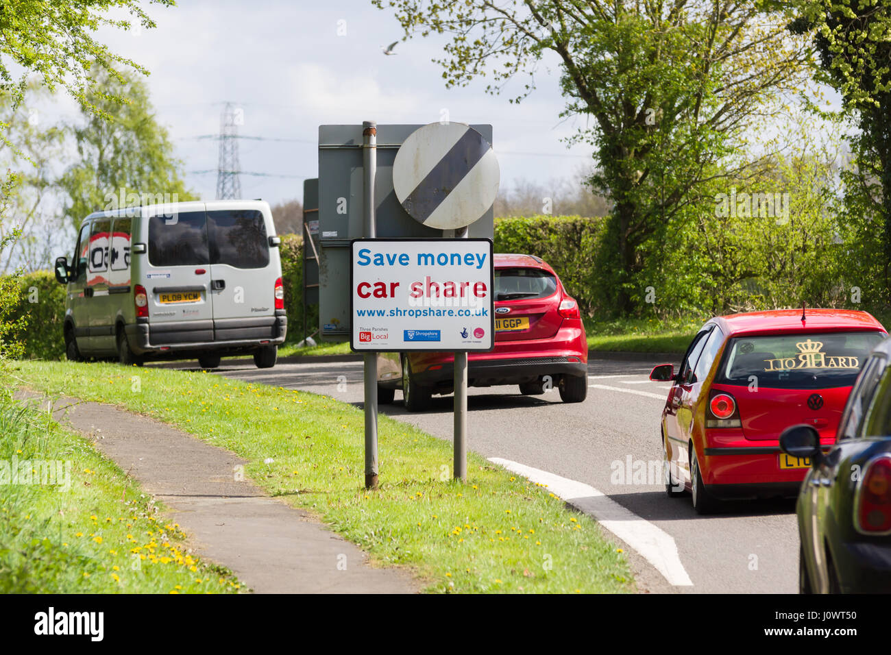 Roadside sign erected by Shropshare Carshare Shropshire and Telford advising drivers of car sharing or pooling to Stock Photo