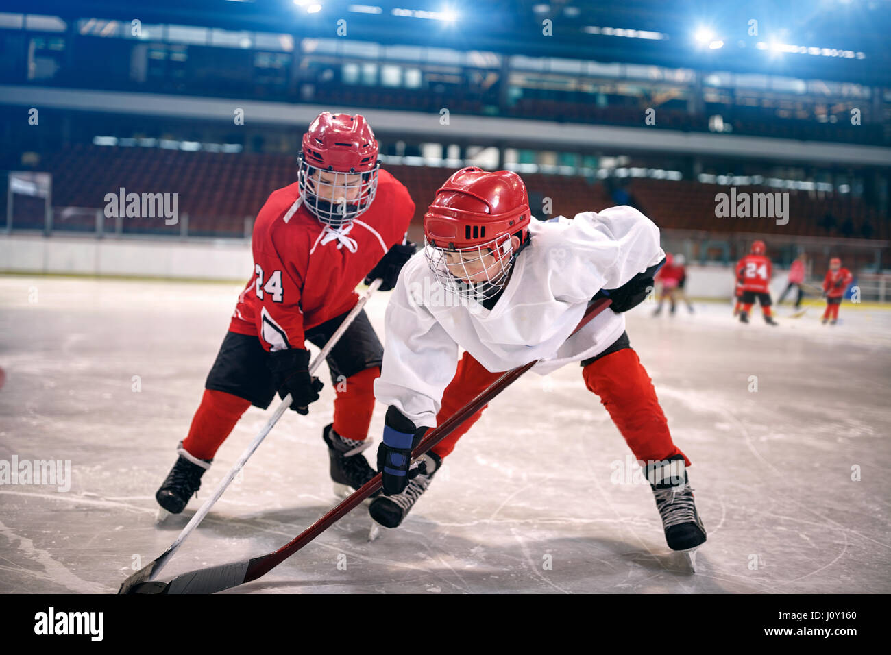 young children play ice hockey - Stock Image