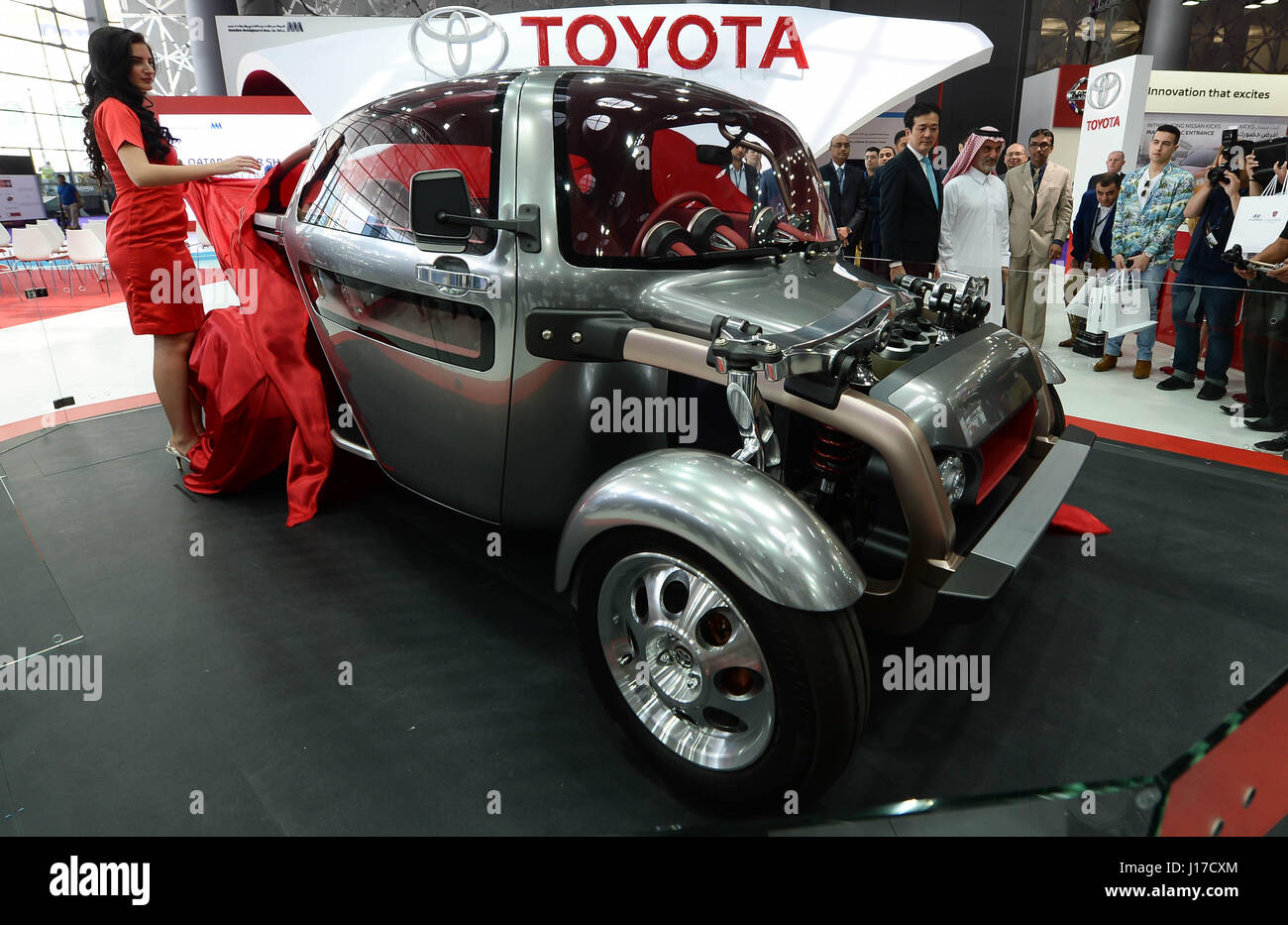 Doha, Capital of Qatar. 18th Apr, 2017. Visitors look at the Toyota KIKAI during the Qatar Motor Show 2017 at the - Stock Image