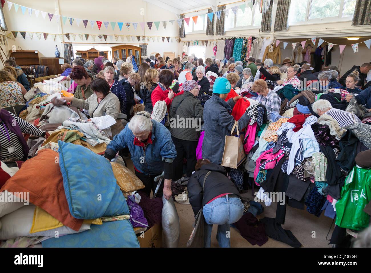 jumble sale, village hall, crowd of people, hamstreet, ashford, kent, uk Stock Photo