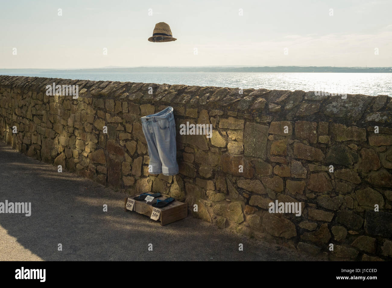 An invisible man installation at St Ives, Cornwall where tourists and locals can take a selife with the invisible Stock Photo