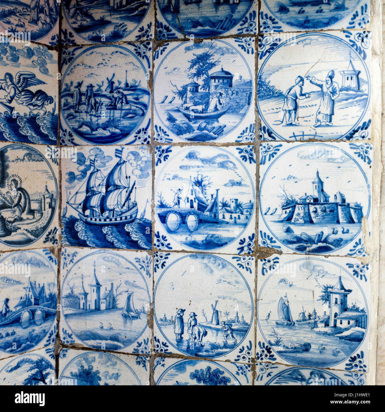 Blue and white illustrated seafaring wall tiles. - Stock Image