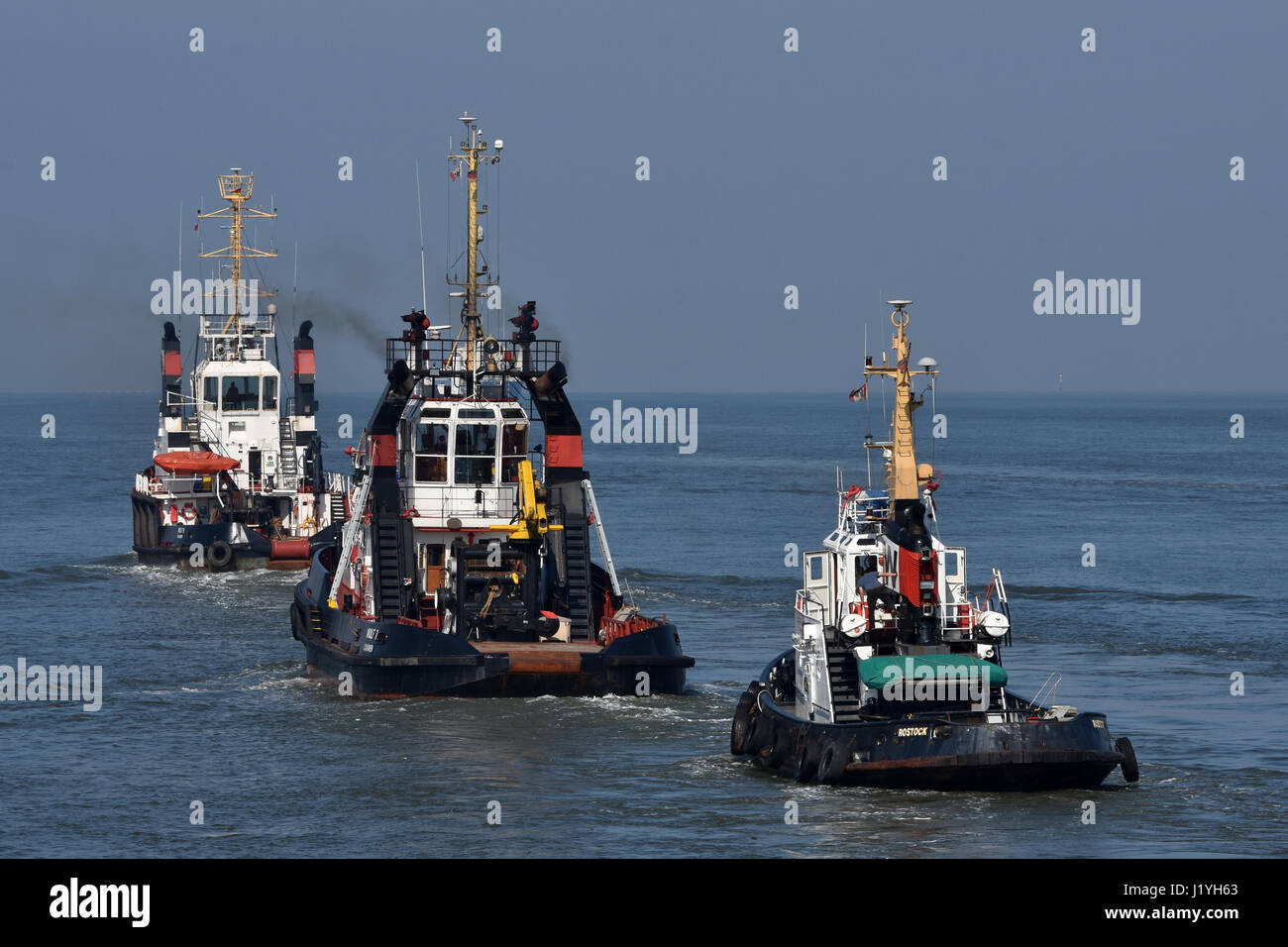 Wulf tugboats heading for sea Stock Photo