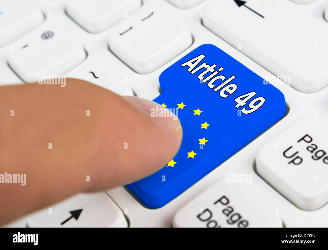 Finger pressing an Article 49 button to invoke Article 49 of the Lisbon Treaty for entering the EU. - Stock Image
