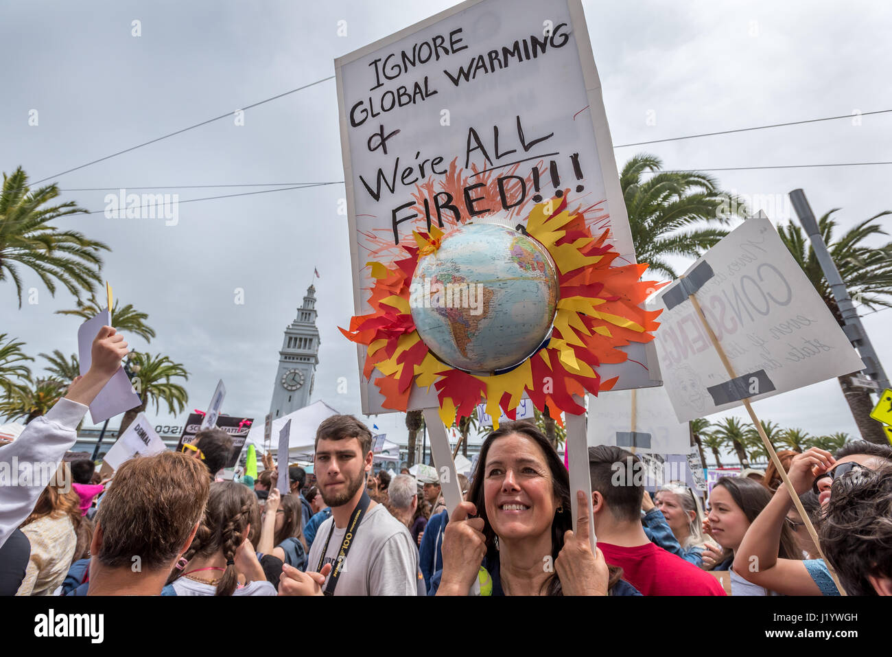 San Francisco, California, USA. 22nd April, 2017. 'Ignore global warming and we're all fired!!!' reads - Stock Image