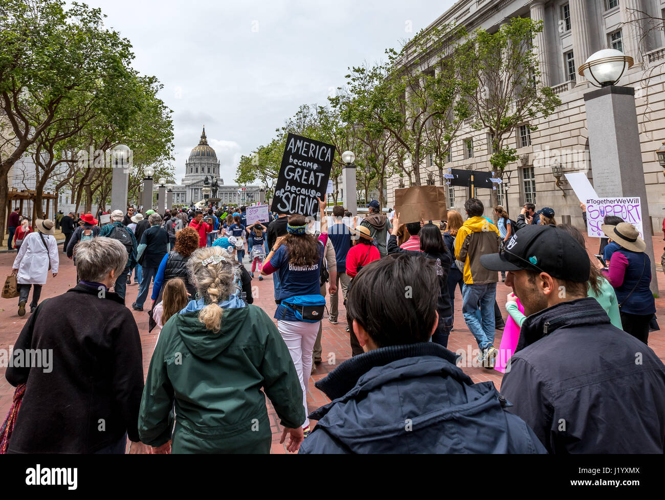San Francisco, California, USA. 22nd April, 2017. Earth Day marchers approach San Francisco City Hall and the Civic - Stock Image