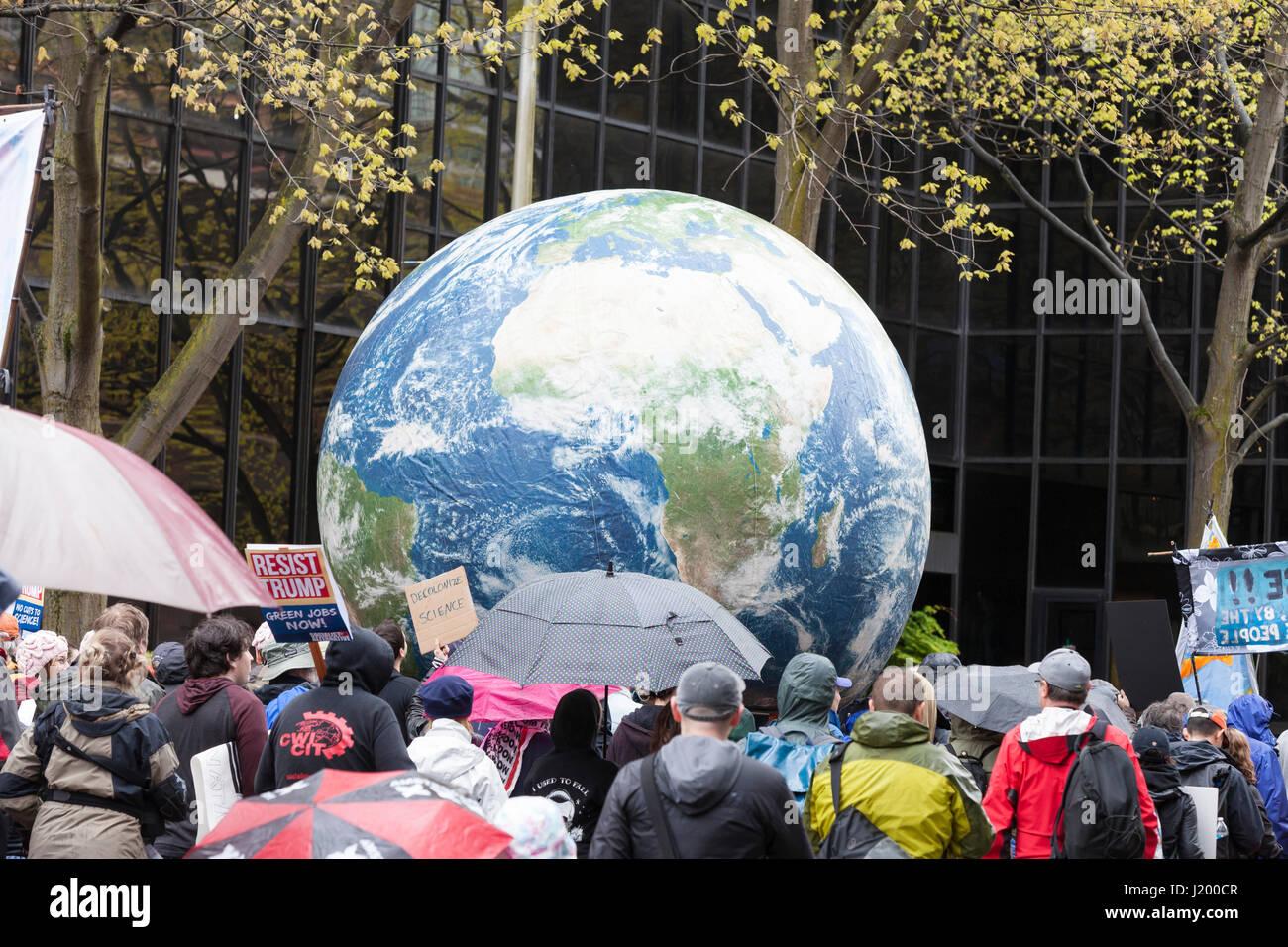 Seattle, Washington,USA. 22nd April, 2017. A large globe makes its way along 4th Avenue on its way to Seattle Center. - Stock Image