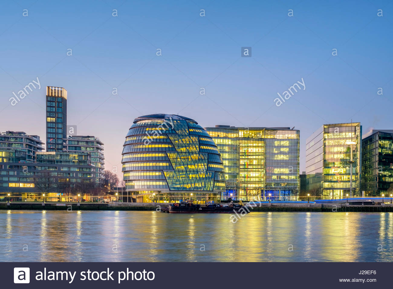 United Kingdom, England, London. London City Hall designed by architecht Norman Foster, and modern buildings in - Stock Image