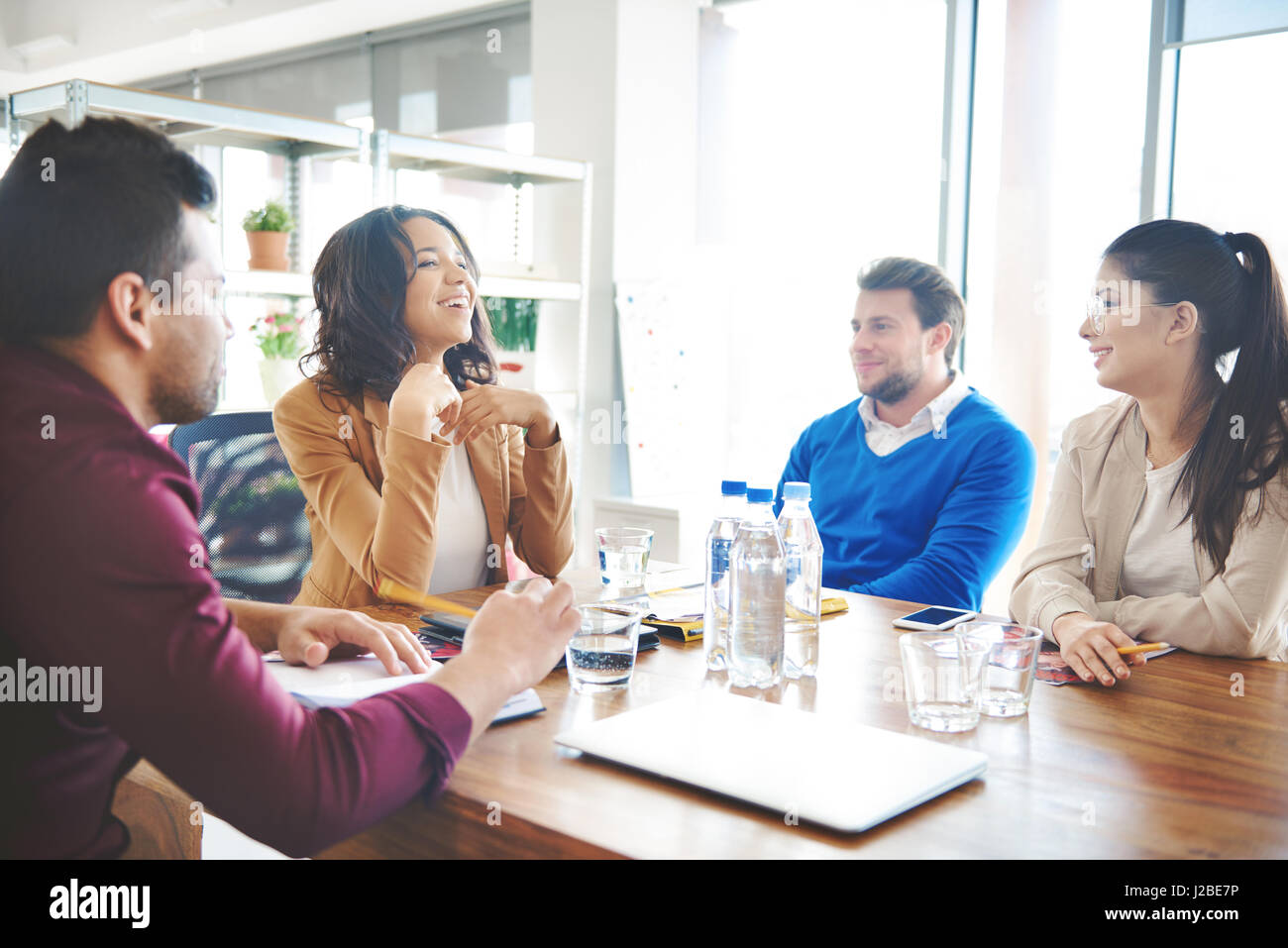 Group of business people discussing at work - Stock Image