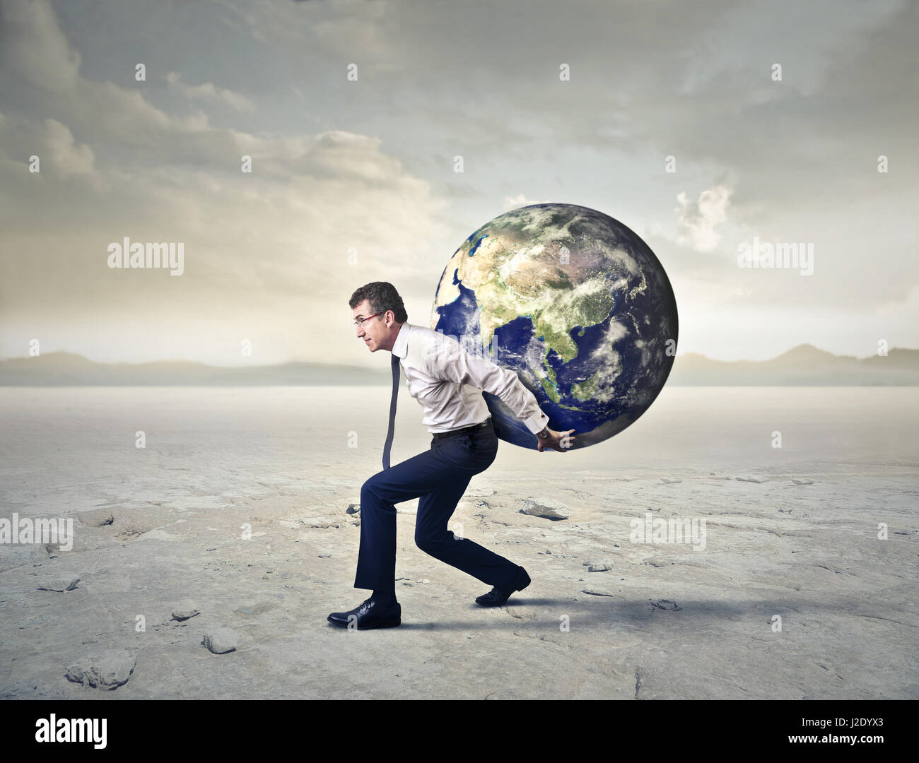 businessman carrying earth on his back stock photo 139219531 alamy