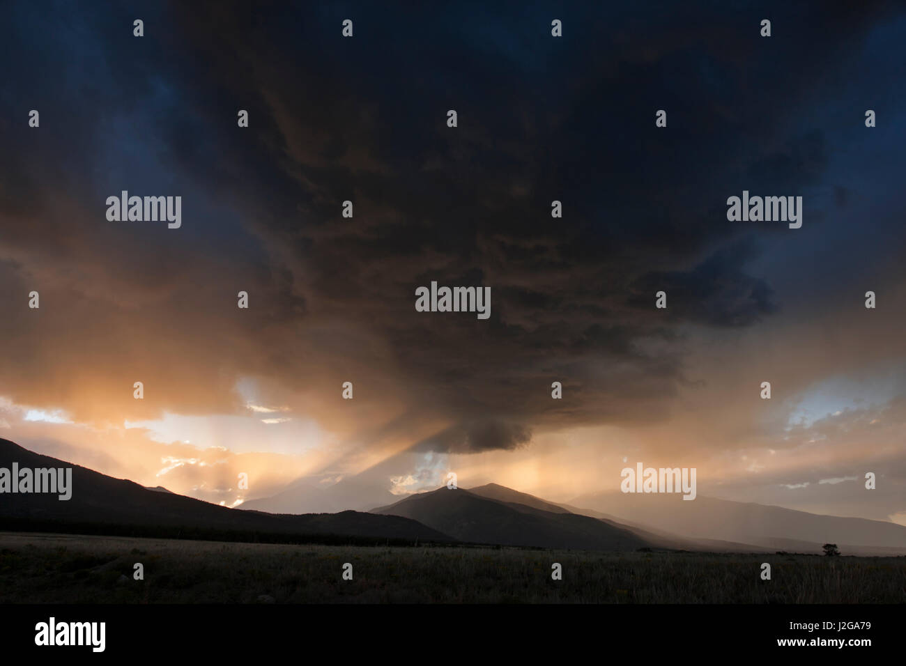 USA, Colorado, Collegiate Range. Storm clouds over mountain at sunset. Credit as: Don Grall / Jaynes Gallery / DanitaDelimont.com - Stock Image