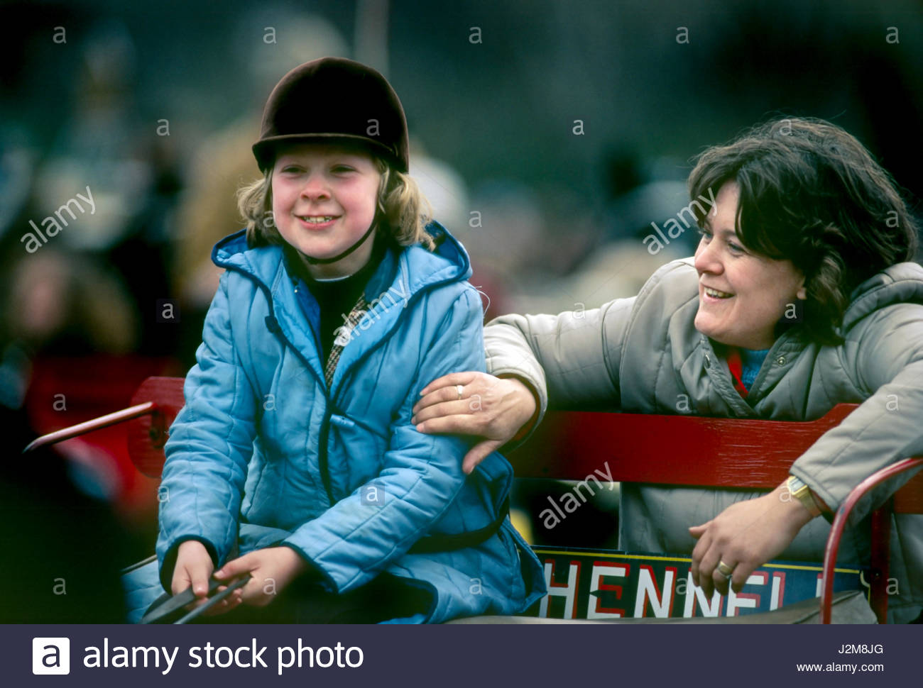 Harness horse parade, early morning. Woman showing a young girl how to handle a buggy and horse, Inner circle Regent's Stock Photo