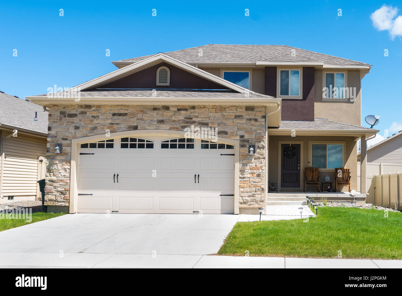Contemporary Split Level House With Garage In Front Stock Photo