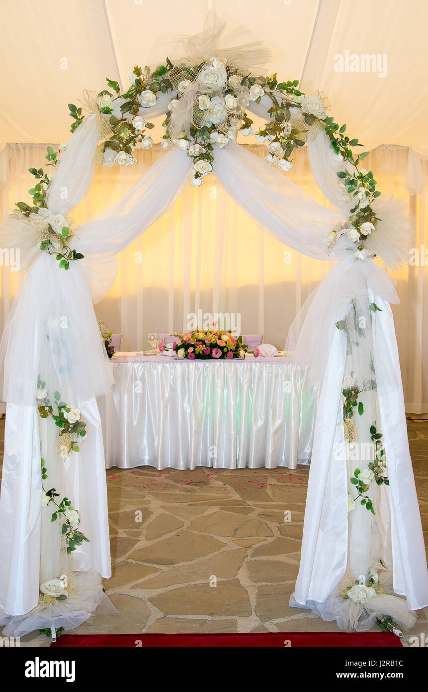 Wedding arch decorated with veil and flowers stock photo 139425816 wedding arch decorated with veil and flowers junglespirit Images