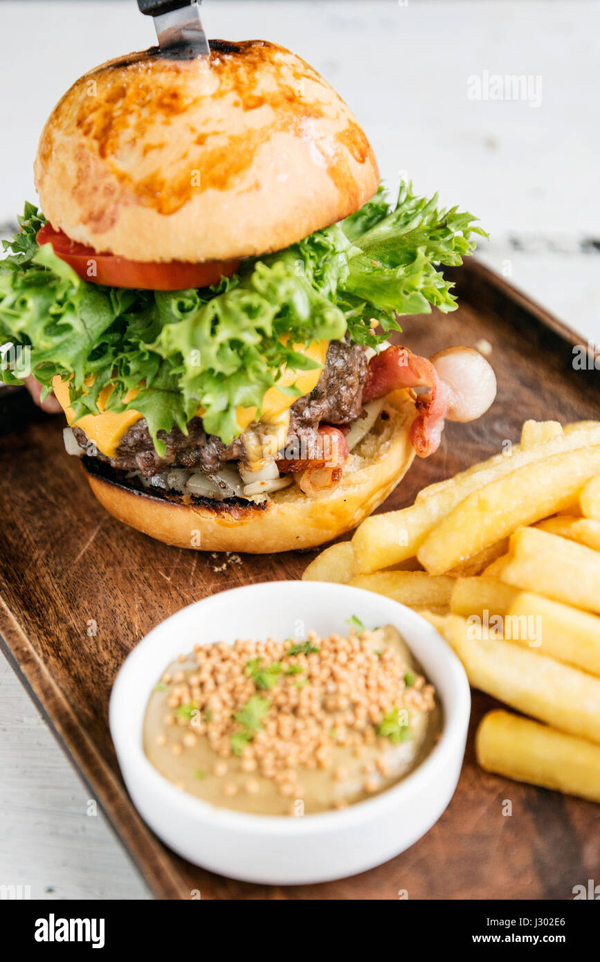 beef burger with fries and mustard sauce set snack meal - Stock Image