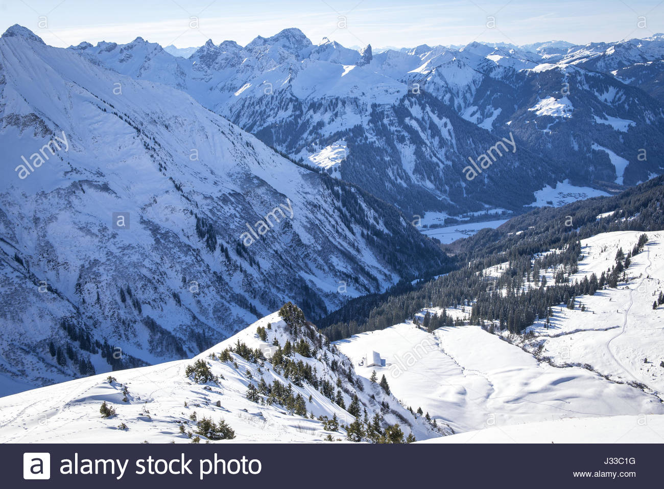 View to the Schwarzwasser valley in winter, sunny and snowy winter landscape, Vorarlberg, Austria - Stock Image