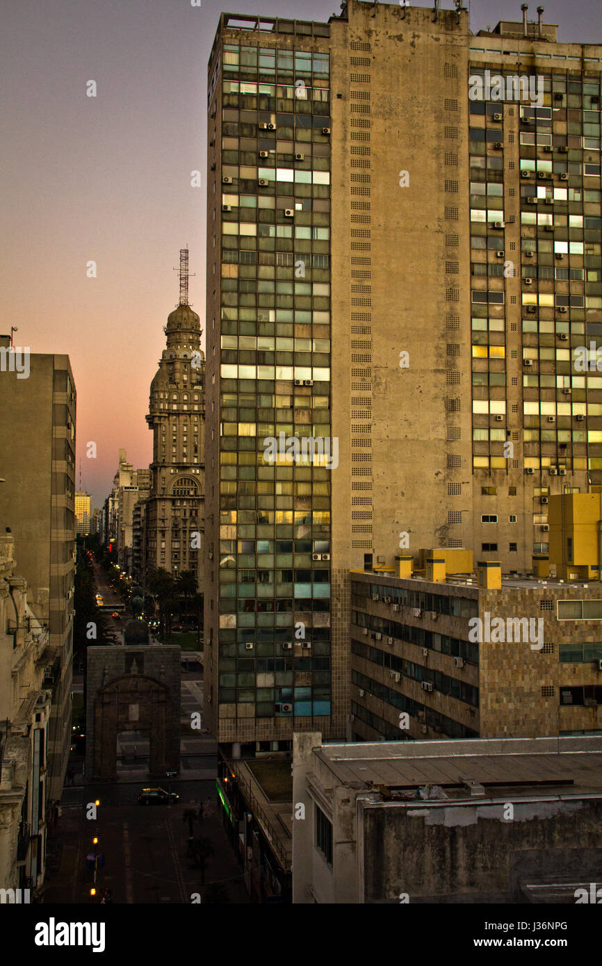 Sunset light in Montevideo with great perspective to the skyline. Buildings in sundown. Colorful light. - Stock Image