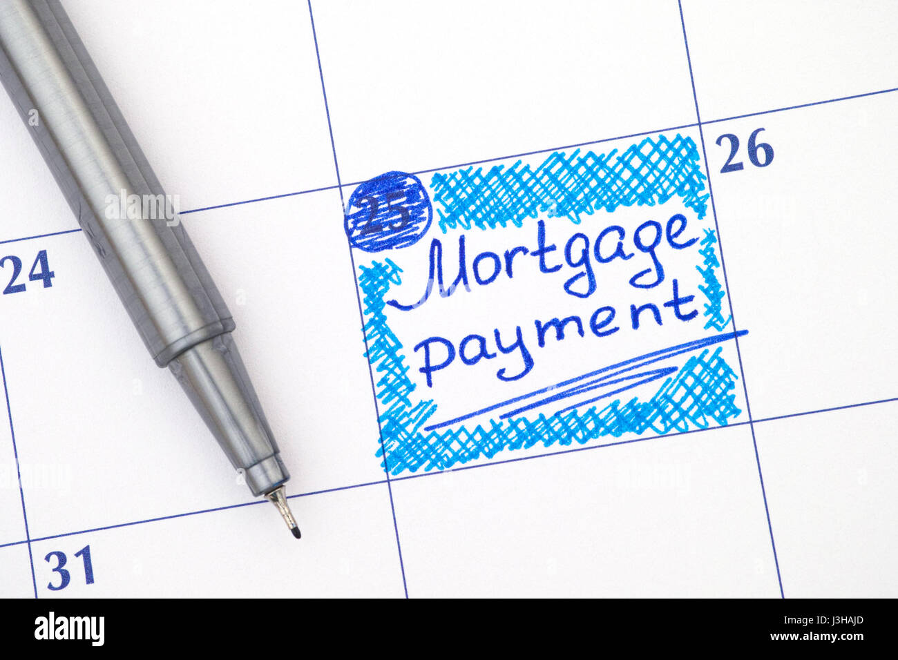 Reminder Mortgage Payment in calendar with blue pen. Stock Photo