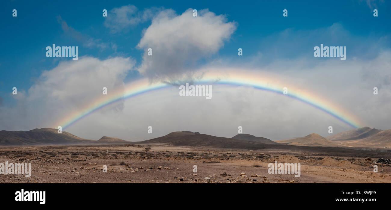 a-full-rainbow-during-a-rare-rain-shower-on-the-arid-semi-desert-mountain-J3WJP9.jpg