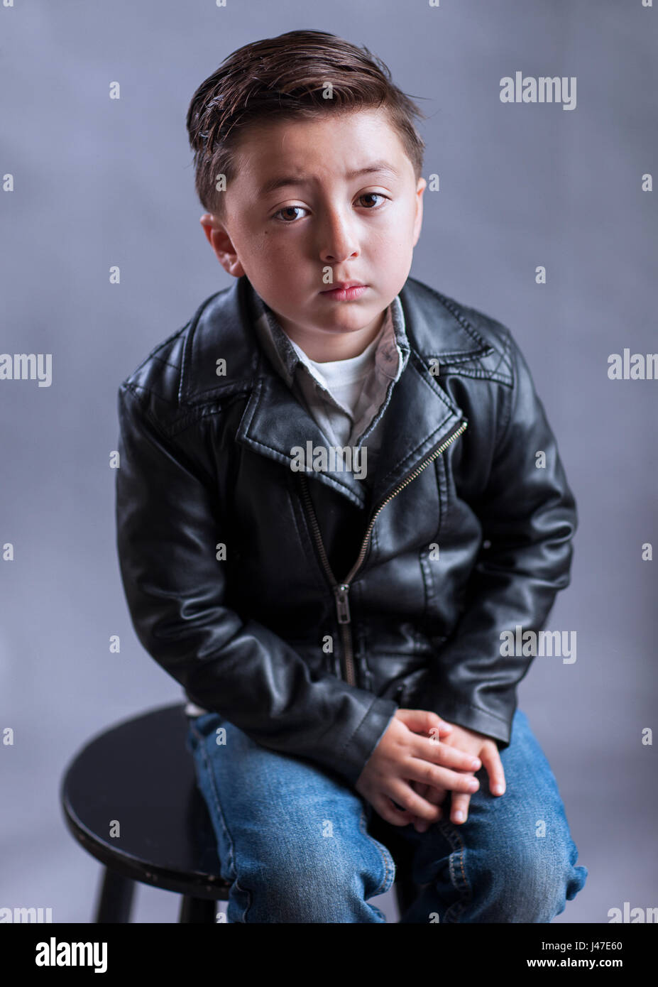 Flannel Motorcycle Jacket >> Punk rock and roll little boy with rockabilly greaser haircut wearing Stock Photo: 140306376 - Alamy