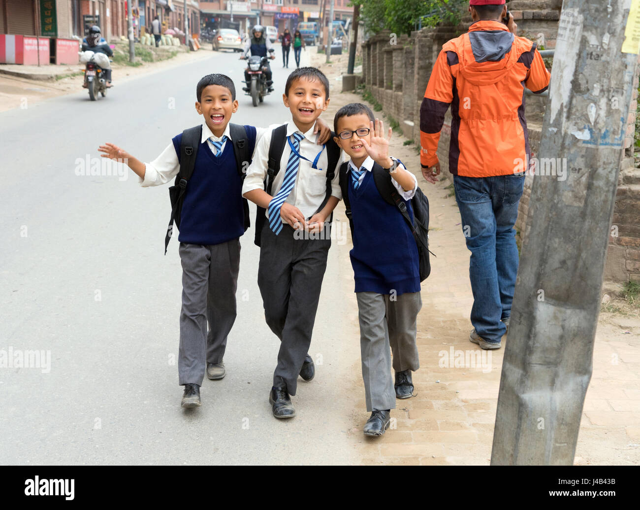 smiling-nepalese-schoolboys-in-uniforms-walking-on-the-street-bhaktapur-J4B43B.jpg