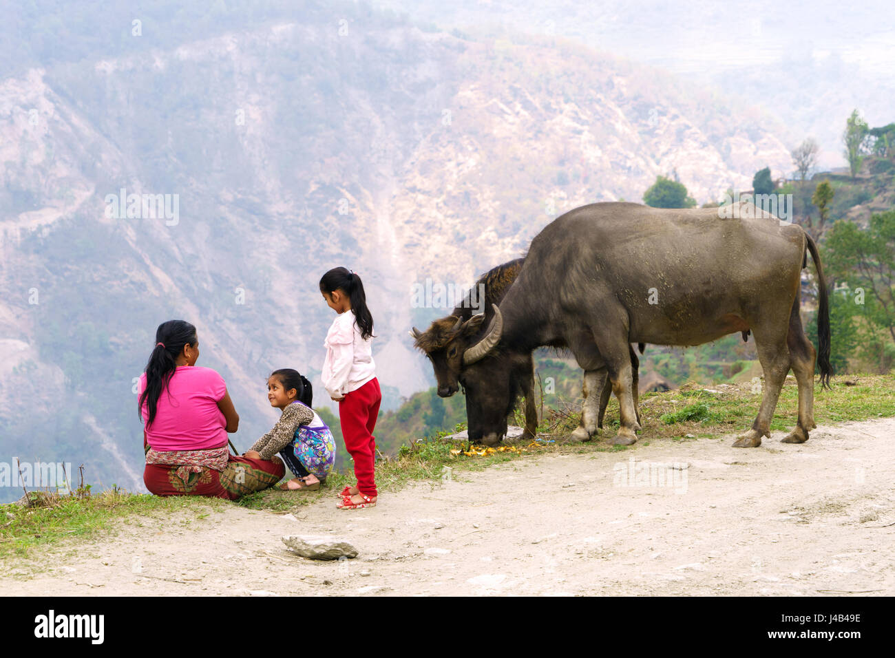 nepalese-woman-with-her-daughters-near-landruk-annapurna-region-J4B49E.jpg