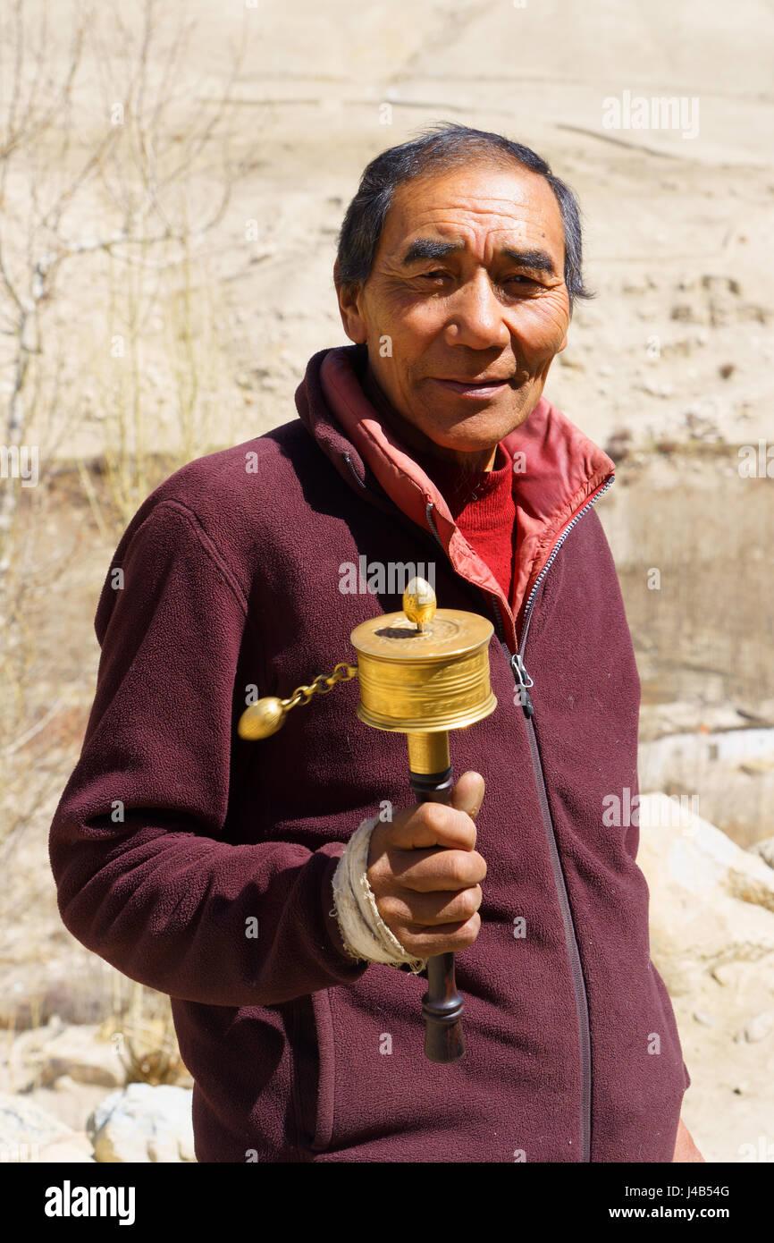 nepalese-man-turning-his-prayer-wheel-J4B54G.jpg
