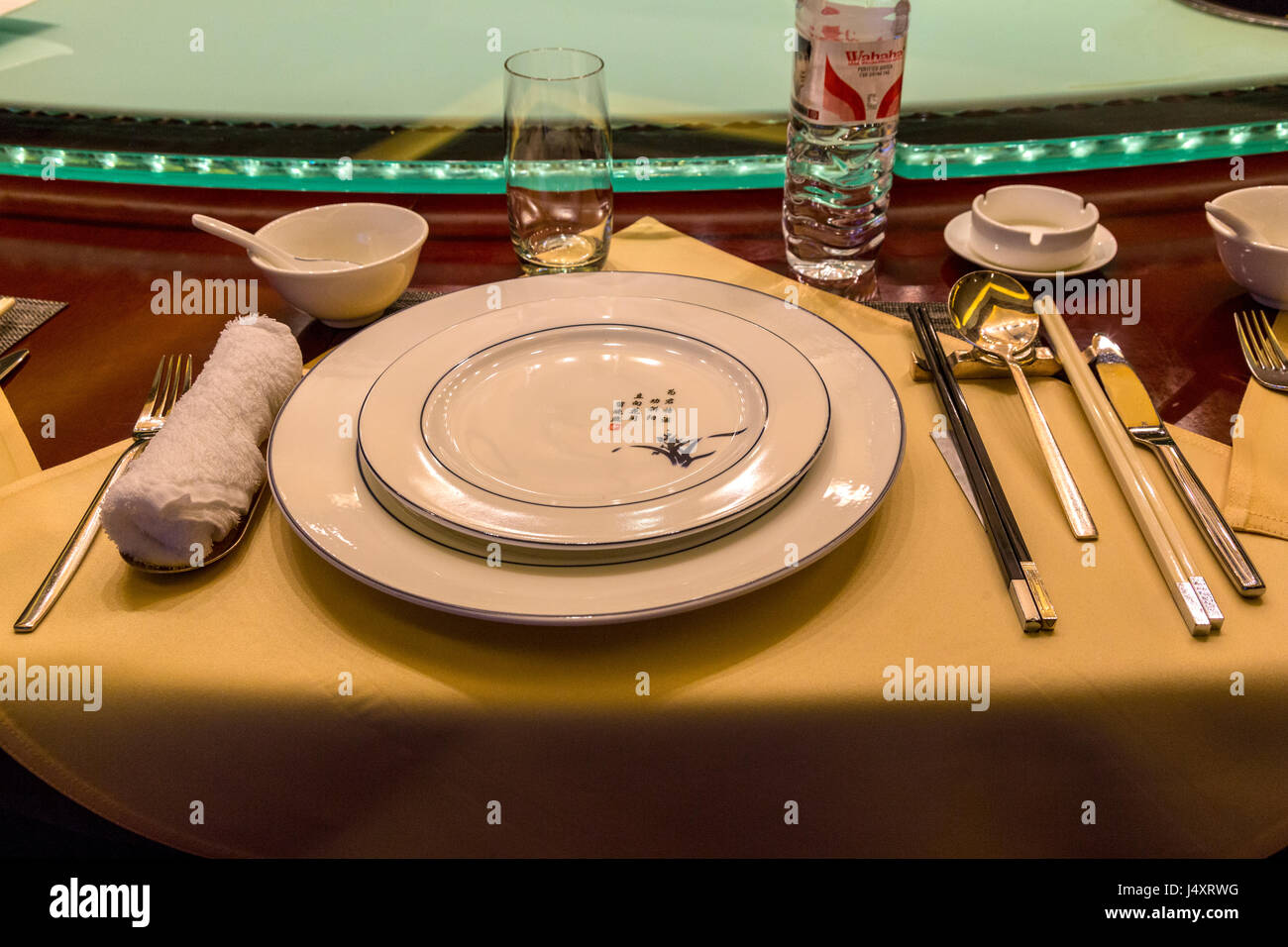 China. Chinese Table Place Setting with Chopsticks. Lazy Susan (Rotating Serving Table) in background & China. Chinese Table Place Setting with Chopsticks. Lazy Susan Stock ...