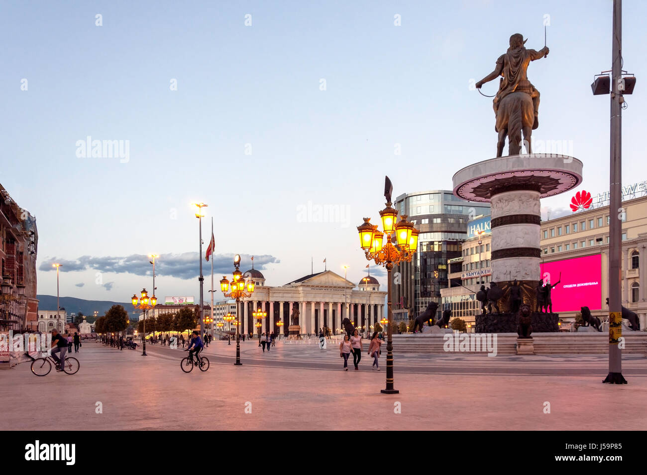 Warrior on a Horse statue and fountains at dusk, Macedonia Square, Skopje, Skopje Region, Republic of Macedonia Stock Photo