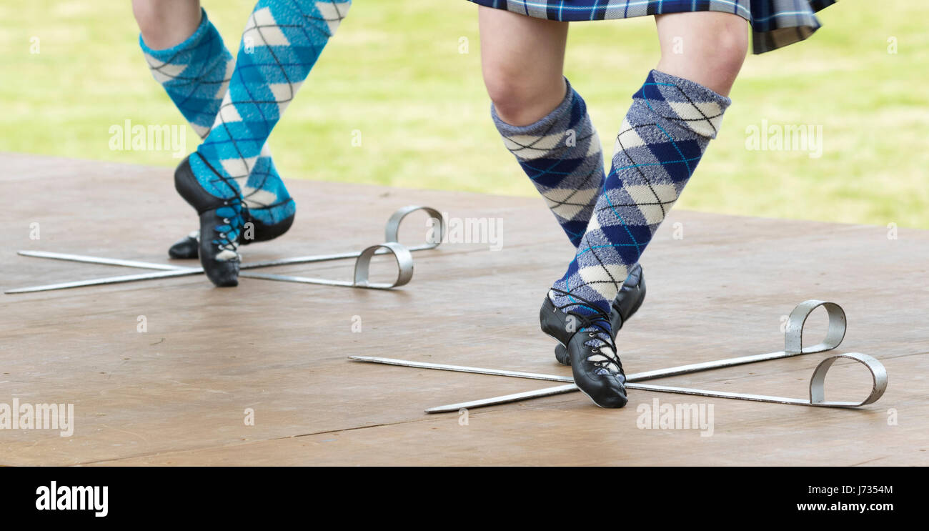 Fochabers, Scotland - May 21, 2017: Two Highland Dancers performing a traditional Sword Dance during the Highland Stock Photo