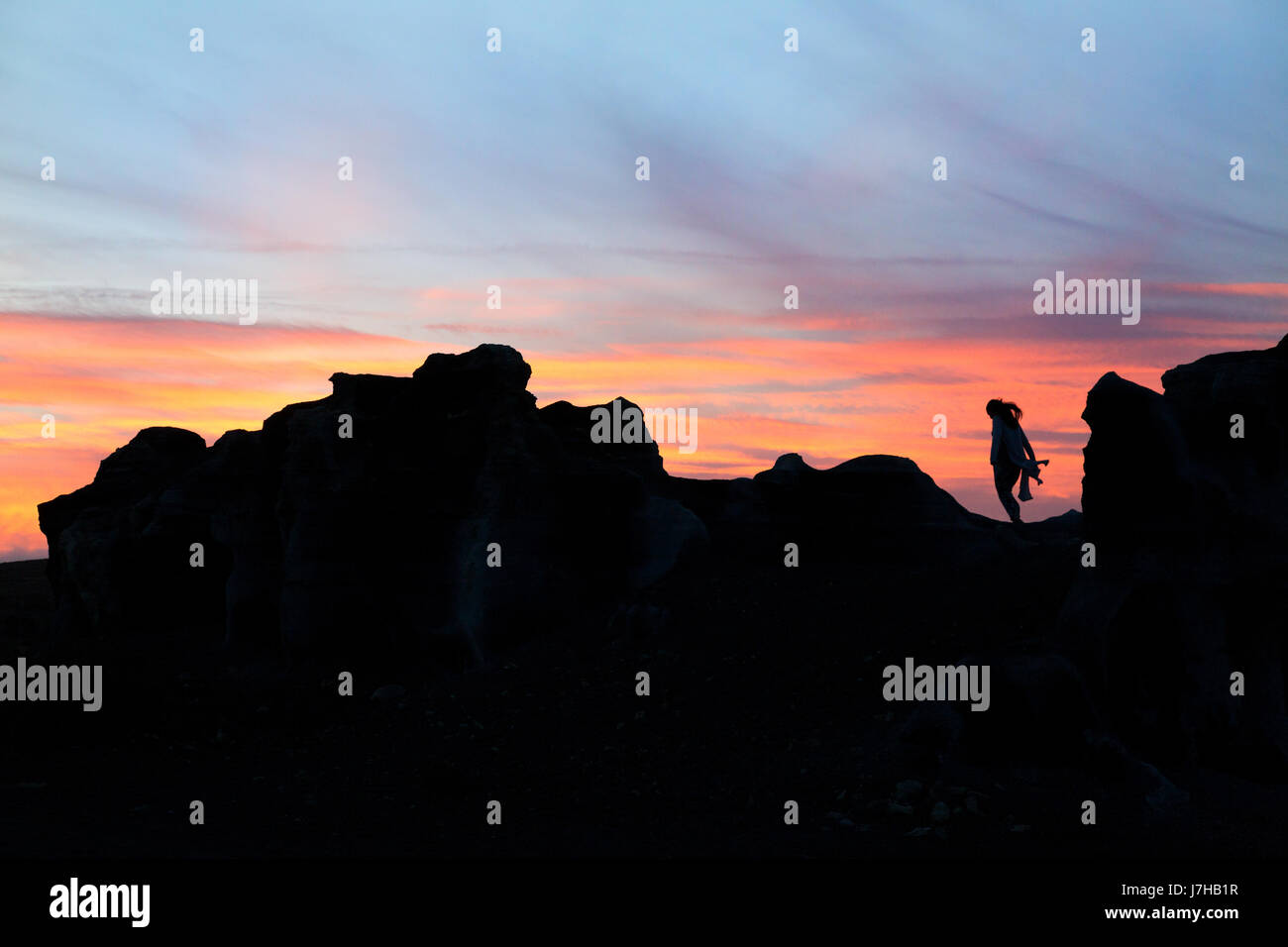 lanzarote-sunset-a-woman-standing-on-a-v