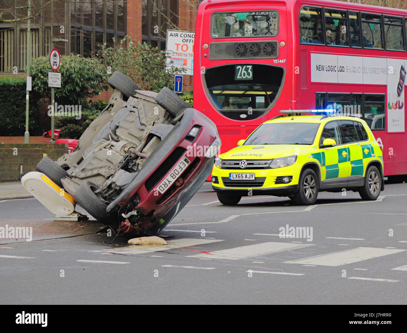 Car upside down after hitting curb - Stock Image